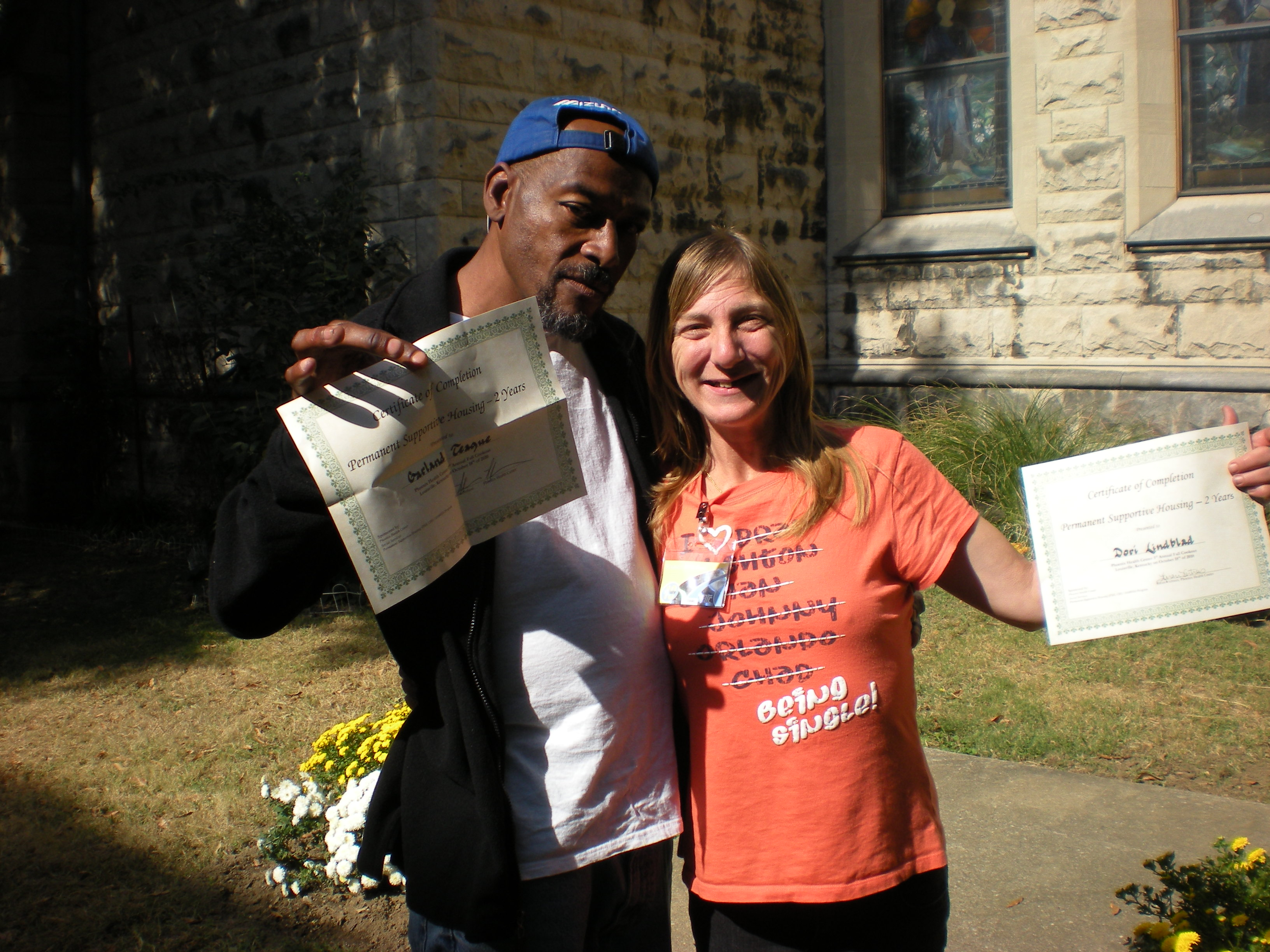 At the program's 2010 fall cookout, Garland Teague and Dori Wilson received certificates for recognition of two successful years in housing.