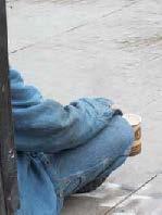 homeless sitting on the sidewalk