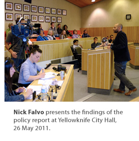 Nick Falvo presents the findings of the policy report at Yellowknife City Hall, 26 May 2011